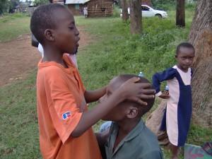 Lukonyi-busia, boy prays,2,